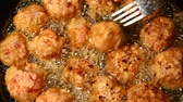 quibe : Macro of meat balls cooking in oil