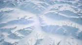 tops : aerial view of snow covered terrain Stock Footage