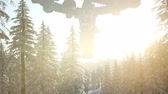 abduction : UFO hovering over a forest at sunset with light beam