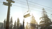 kukuleta : empty ski lift. chairlift silhouette on high mountain over the forest at sunset