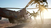 кокпит : old rusted military helicopter in the desert at sunset