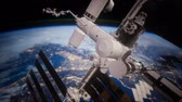 space station : A view of the Earth and a spaceship. orbiting the Earth Stock Footage