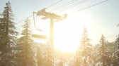 ascensore : empty ski lift. chairlift silhouette on high mountain over the forest at sunset