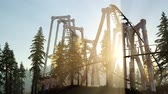 поднятый : old roller coaster at sunset in forest