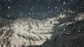 on piste : Heavy snowing, focused on the snowflakes, mountains in the background Stock Footage