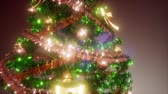 bombki : Joyful studio shot of a Christmas tree with colorful lights