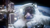 vacuuming : Astronaut at spacewalk. Elements of this image furnished by NASA Stock Footage