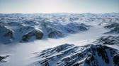pinguin : 8K Aerial Landscape of snowy mountains and icy shores in Antarctica Stockvideo