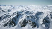 кит : 8K Aerial Landscape of snowy mountains and icy shores in Antarctica Стоковые видеозаписи