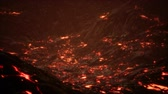 溶岩 : Red Orange vibrant Molten Lava flowing onto grey lavafield and glossy rocky land 動画素材