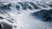 gleccser : 8K Aerial Landscape of snowy mountains and icy shores in Antarctica Stock mozgókép