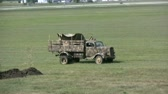 exército : Old military truck in a field