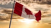 memorial : Canada Flag, HQ animated on an epic sunset background  ready to use animation of the canadian flag animated on an epic background with fast moving clouds.