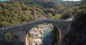 gras : Aerial, Pont Medieval De Lllierca, Pyrenees, Spain - graded Version Stock Footage