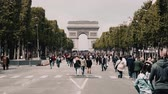 triumphal arch : Tourists Walking The Avenue Des Champs-Elysees, Paris Stock Footage