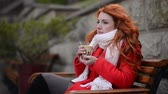 red : Woman drinking hot coffee, cold autumn day Stock Footage