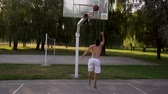 fitness : Young man plays basketball and throws the ball into the basket, slow motion Stock Footage