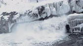 geográfico : water flows down from the glacier with a swift stream Vídeos