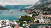 Top view of bay with moored cruise liner, drone shot, Kotor, Montenegro Stok Video