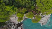 intocado : top view of rocky shore of crystal clear Adriatic Sea, drone shot