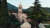 avlu : aerial view of ancient monastery in Montenegro, drone shot Stok Video