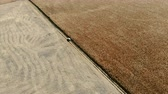 capturados : aerial view of car traveling in large field Stock Footage