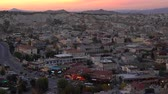 erodált : panorama of Goreme in Cappadocia after sunset Stock mozgókép