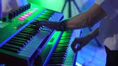 zongora : keyboard player playing synthesizer during band performance, close-up