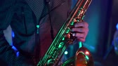 alto : male hands playing saxophone in nightclub, close-up Stock Footage