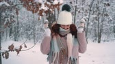 parques : woman playing with snow in park, slow motion Stock Footage