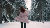 parques : joyful female whirl in winter forest Stock Footage