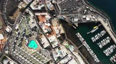 sailboat : Drone shot over city of Puerto Del Carmen, Canary Islands, Spain Stock Footage