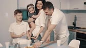 rozmowa : Happy family eating cookies in kitchen