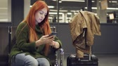 ожидая : Female is waiting for delayed flight at night airport.