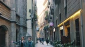 BARCELONA, SPAIN - FEBRUARY 19, 2019: Old streets of Gothic Quarter of Barcelona, Catalonia