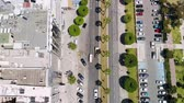 limassol : Aerial view of busy street of resort town with parking lots and passing cars