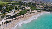 데 : Aerial view of sandy beach and people resting on it, Cyprus, Coral Bay 무비클립