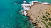 falésias : Aerial view of rocky Mediterranean coast in Cyprus on sunny day Vídeos