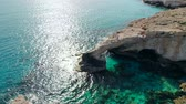 pedras : Aerial view of Lovers Bridge on rocky shore of Mediterranean, Cyprus Stock Footage