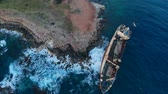 roncs : Abandoned ship stranded on shores of Mediterranean Sea, view from above