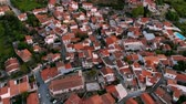 falu : Flying over red roofs of authentic mountain village in central Cyprus Stock mozgókép