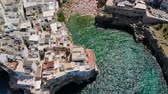 zeepaard : Aerial View of sea from Polignano a Mare and beach with tourists, Puglia, Italy Stockvideo