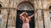 female cell : Happy woman tourist takes selfie on streets of old city, Italy, Puglia