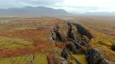 hiba : Autumn landscape in Iceland, rocky canyon on background of mountain, drone shot