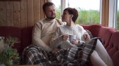 deštivý : Couple sitting and hugging on sofa at home Dostupné videozáznamy