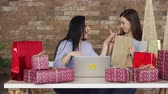 Two girlfriends show each other their purchases, black Friday concept. Stock Footage