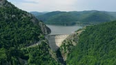 hidro : Aerial view of a hydroelectric dam in the mountains covered with forest, a drone flies around