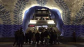 STOCKHOLM, SWEDEN - DECEMBER 4, 2019: People on the station T-Centralen of Stockholm. Passengers rise on the escalator. Dostupné videozáznamy