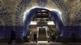 STOCKHOLM, SWEDEN - DECEMBER 4, 2019: People on the station T-Centralen of Stockholm. View of the escalator. Dostupné videozáznamy