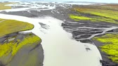 erosão : Aerial view of a glacier river delta flows into the Atlantic Ocean, Iceland. Drone shot. Vídeos